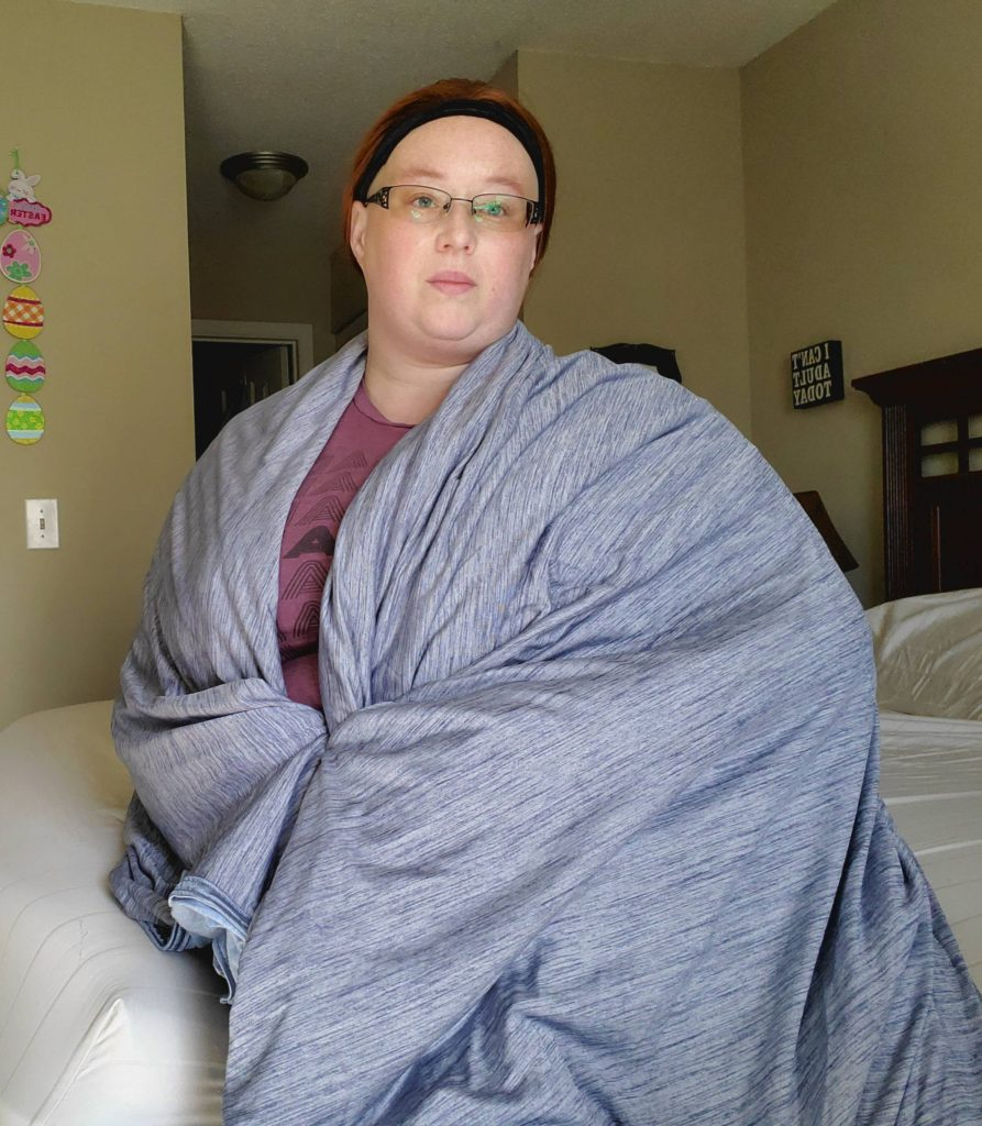 Writer wearing the cooling blanket