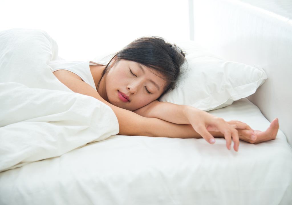Asian women sleeping in a white bed